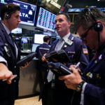 STOCKS WERE LITTLE CHANGED Monday morning after the S&P 500 Index climbed for four straight weeks to an all-time high.  / BLOOMBERG NEWS FILE PHOTO/JIN LEE