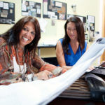MATERIAL GIRL: Julie A. Lancia, left, founded ALX Group 12 years ago, growing the firm's reputation through interesting work and use of creative materials. At right is her assistant, Gloria Fournier. / PBN FILE PHOTO/RUPERT WHITELEY