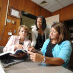 """TEACH YOUR TEACHERS WELL: Christine Alves, center, director of The Teaching Studio, sees herself as """"an instructional coach"""" for other teachers. Here she works with Giovanna Donovan, left, superintendent of the Woonsocket schools, and Donna Coderre, principal of Leo Savoie Elementary School in Woonsocket. / PBN PHOTO/BRIAN MCDONALD"""