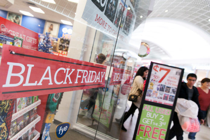MUSIC TO THEIR EARS: Black Friday foot traffic at Warwick Mall was brisk, with retailers including FYE offering promotions attempting to lure shoppers. / PBN PHOTO/DAVID LEVESQUE