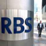 MOODY'S INVESTORS SERVICE may downgrade Royal Bank of Scotland as a result of the bank saying that full-year results would be affected by extraordinary charges and costs. / BLOOMBERG FILE PHOTO/SIMON DAWSON