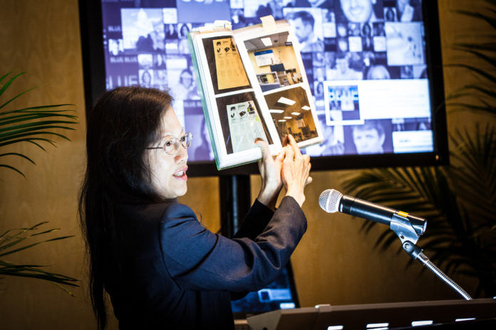 CARE TECHNOLOGY EXECUTIVE VICE PRESIDENT BELINDA WONG, part of the winning team at last year's inaugural Get Started RI event, shows how the company's linear LED lighting system makes a brighter, more inviting environment than traditional commercial lighting solutions. / COURTESY COX BUSINESS