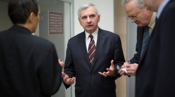 R.I. SEN. JACK REED, center, introduced a bill this week that would add the New York Fed chief to the list of central bank officials who must be nominated by the president and confirmed by the Senate. / BLOOMBERG NEWS PHOTO/ANDREW HARRER