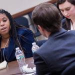 """TRIAL RUN: Stesha Emmanuel, left, attorney for LeClairRyan of Boston, """"deposes"""" actor Chris Stahl during a workshop at the Litigation Academy. / PBN PHOTO/ MICHAEL SALERNO"""
