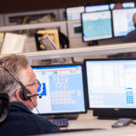 GETTING THE CALL: A report from Brown University's Taubman Center recommends consolidating municipal 911 services across Rhode Island. Above, a 911 dispatcher works at the Scituate call center. / PBN PHOTO/MICHAEL SALERNO