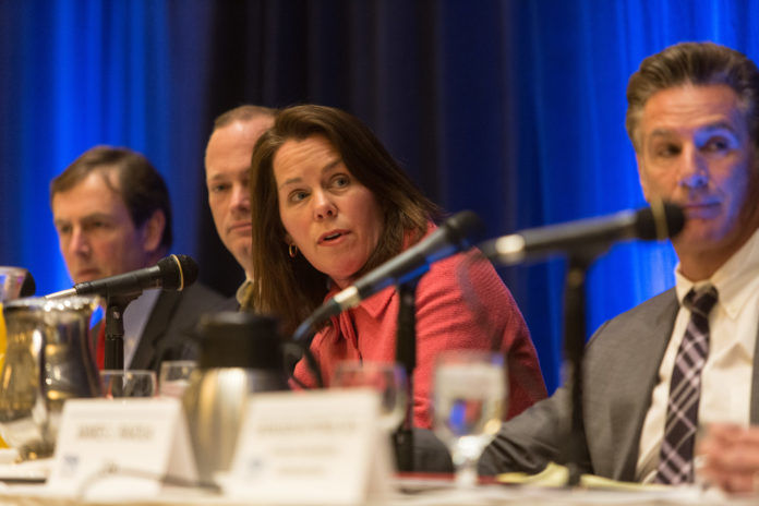 ANYA RADER WALLACK, DIRECTOR of HealthSource RI, explained that the new assessment on health care premiums for individuals would be 3.76 percent and 1 percent for small businesses. She is shown at a recent PBN Summit on health care reform and the insurance exchange. Panelists included from left to right, Sam Slade, president of USI Insurance RI's Employee Benefits Division; Peter Marino, president and CEO of Neighborhood Health Plan RI; Wallack; and James J. Raiola, a career agent with MassMutual and advisory board member of HealthSource RI. / PBN FILE PHOTO/RUPERT WHITELY
