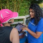 BUILDING BLOCKS: UnitedHealthcare representative Kavita Patel, right, demonstrates mobile Web app Baby Blocks to Angelia Duran. / PBN PHOTO/TRACY JENKINS