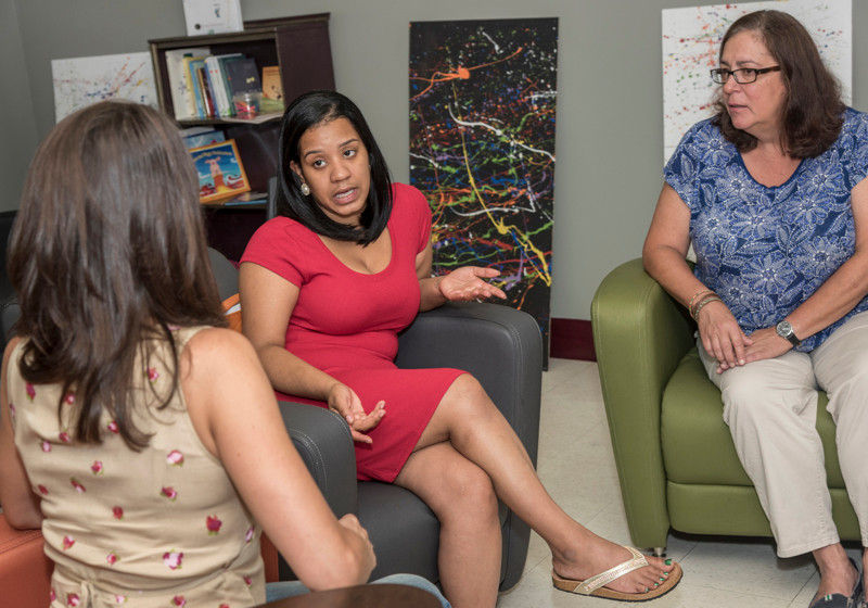 TAKING THE LEAD: Thaysha Mejina, center, speaks with Jennifer Rossi, left, program coordinator for the Environmental Justice League of Rhode Island, and Judith Russell, right, nurse at Nowell Leadership Academy, where Thaysha is a student. / PBN PHOTO/ MICHAEL SALERNO