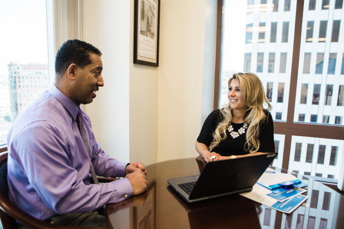 MAKING CONNECTIONS: Deborah Viveiros, vice president and associate relationship manager for Webster Bank, has used her native Rhode Island connections to drive business for the bank. Here she talks with Joe Monteiro, vice president, relationship manager business banking. / PBN PHOTO/RUPERT WHITELEY