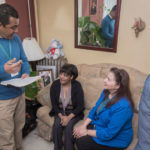 home visits: One of Neighborhood Health Plan of Rhode Island's newest initiatives includes multidisciplinary home health visits. Here Noel Hernandez, left, NHPRI community outreach specialist, and Terri Venditto, right, RN and medical case manager, visit NHPRI member Altagracia Martinez. / PBN PHOTO/MICHAEL SALERNO
