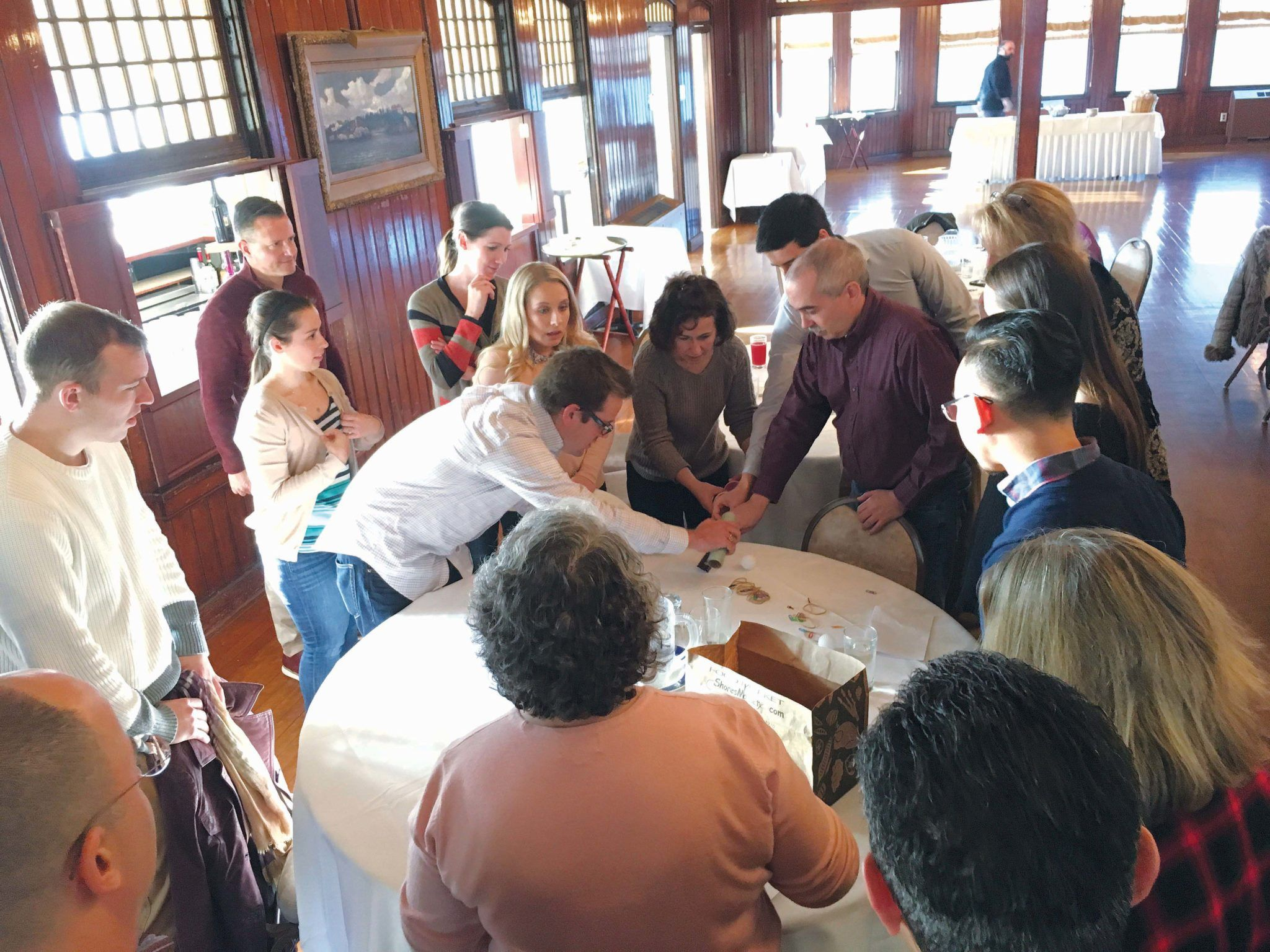 BUILDING A BETTER FIRM: Sansiveri, Kimball & Co. employees take part in team-building exercises during the company's annual all-day retreat at the Squantum Club in East Providence. / COURTESY SANSIVERI, KIMBALL & CO.