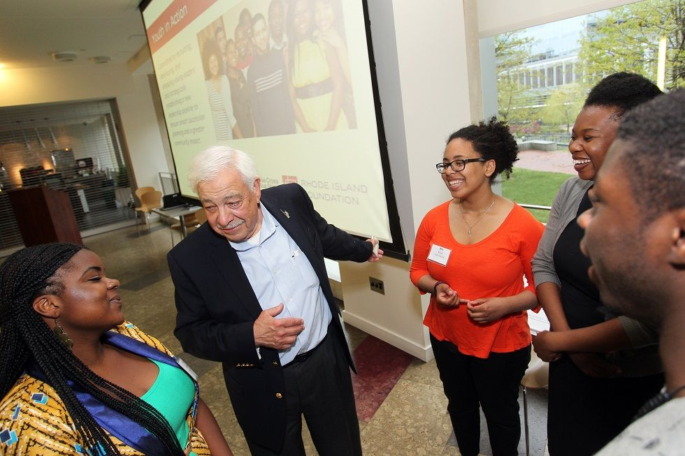 HERMAN ROSE, pictured above second from left, with Youth in Action participants, created the ADDD fund to increase public access to information through the preservation and promotion of print, digital and other formats of historical material. / COURTESY RHODE ISLAND FOUNDATION/STEW MILNE