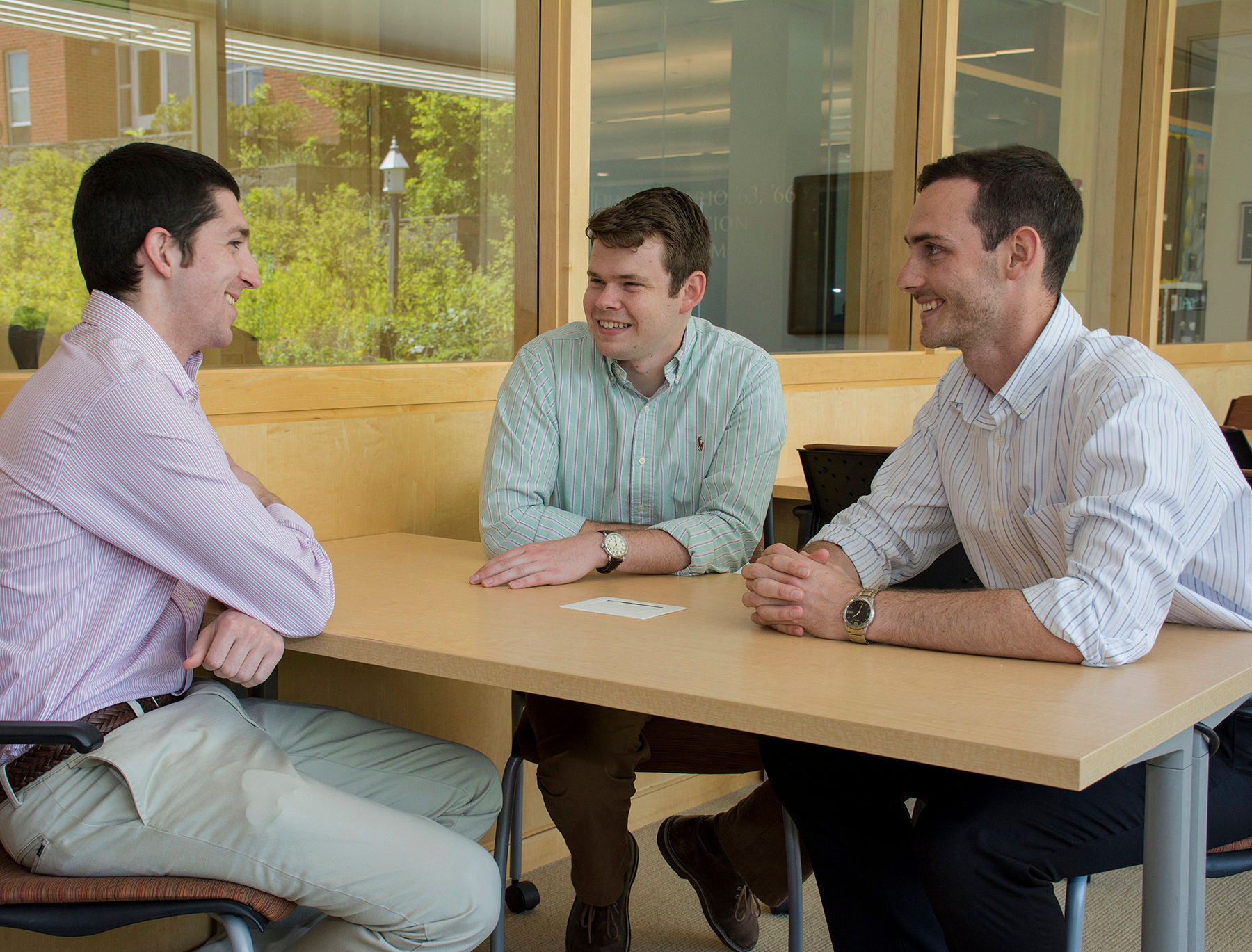 FROM LEFT, Nicholas DaSilva, Kenneth Rose and Benjamin Barlock, doctoral students at the University of Rhode Island's College of Pharmacy, which is part of the Academic Health Collaborative, launched a drug development company, Alcinous. They discuss their venture in the pharmacy building on the Kingston Campus in early June. /COURTESY NORA LEWIS