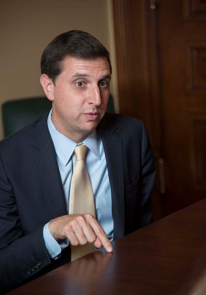 """SETH MAGAZINER, Rhode Island general treasurer, was one of 15 millennial-age elected officials in the Ocean State to write a letter to federal lawmakers, urging the rejection of the Congressional Republicans' tax-cutting legislation known as the """"Tax Cuts and Jobs Act."""" / PBN FILE PHOTO/MICHAEL SALERNO"""