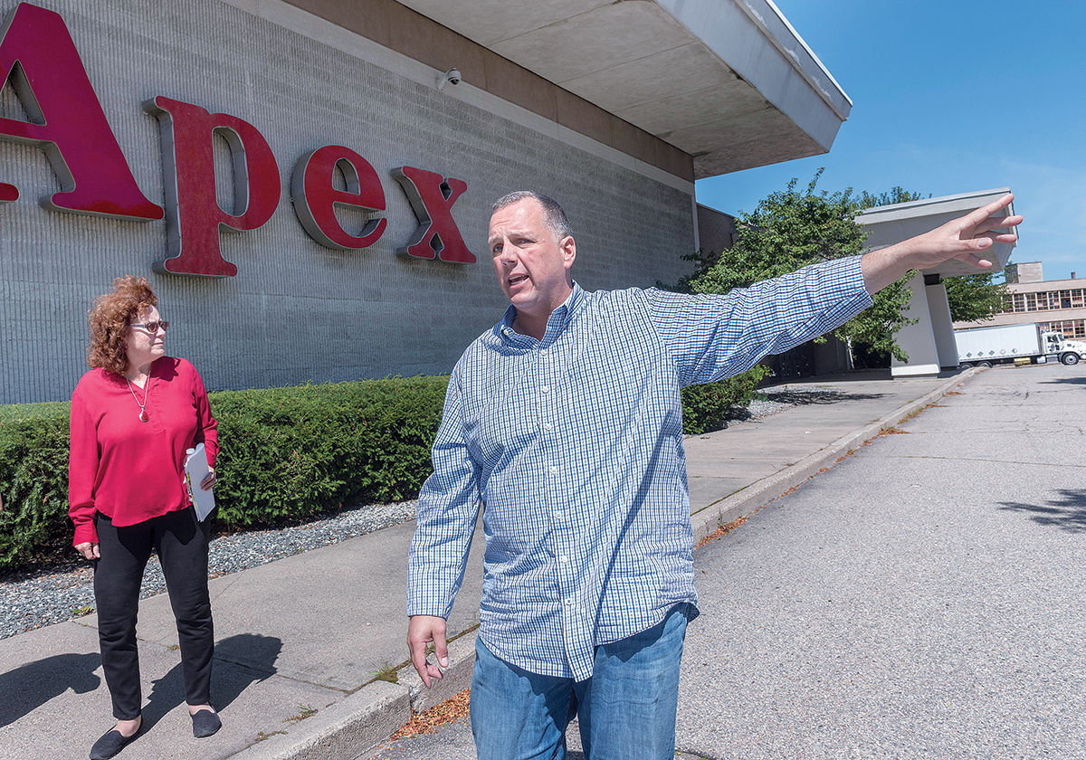 PROPOSED SITE: The Apex Department Store building in Pawtucket, the proposed location of a new PawSox ballpark, can be seen in the background during a walking tour of the city's downtown area with Mayor Donald R. Grebien and Commerce Director Jeanne Boyle. / PBN PHOTO/MICHAEL SALERNO