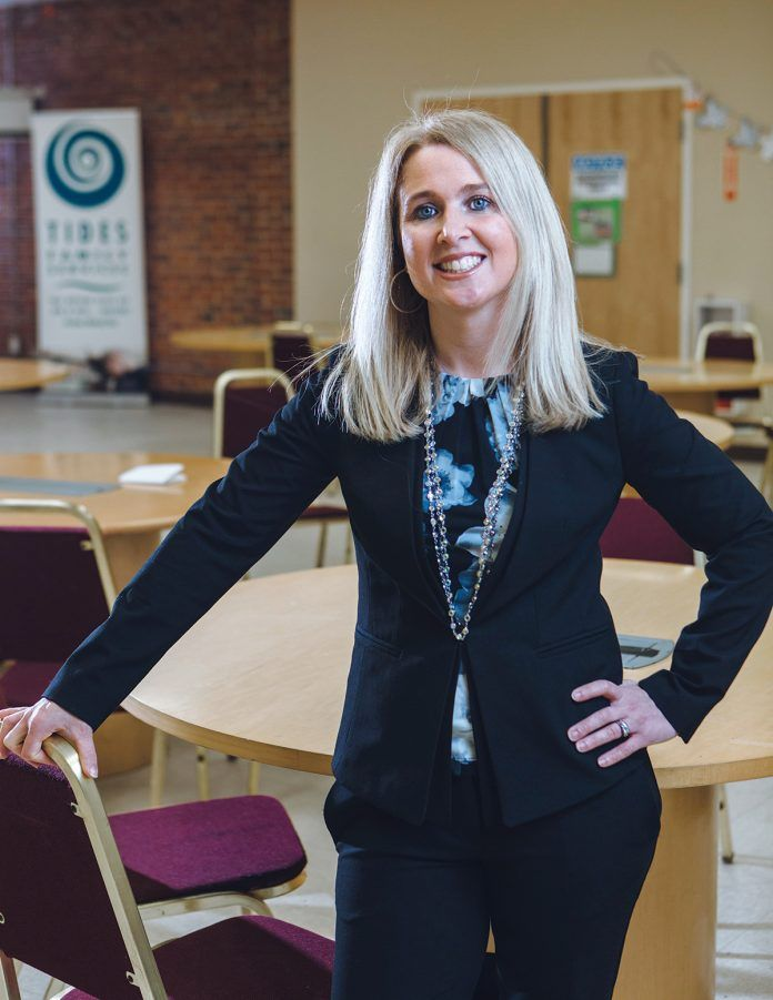 Beth Bixby has worked at Tides Family Services for more than 17 years. Never in her wildest dreams did she anticipate following Brother Michael Reis, the founder and now chief visionary officer, as CEO.  / PBN PHOTO/RUPERT WHITELEY