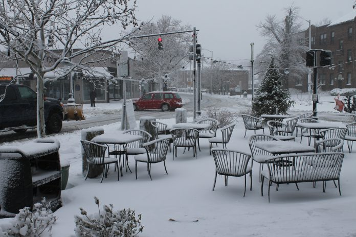 TUESDAY'S NOR'EASTER FORCED L'Artisan Cafe patrons inside at the Wayland Square eatery in Providence. / PBN PHOTO/MARY MACDONALD