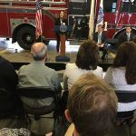 THE RHODE ISLAND FOUNDATION awarded more than $280,000 in grants to improve health care to improve health care in Rhode Island. Harvard Pilgrim Health Care Foundation President Karen Voci, who serves on the advisory committee that recommended the grants, speaks at the announcement Friday morning at the Central Falls Fire Station. / COURTESY RHODE ISLAND FOUNDATION