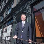 MICRO-LOFTS: Joseph R. Paolino Jr., managing partner of Paolino Properties, stands in front of the new Case-Mead Lofts building at 76 Dorrance St. The Case-Mead Lofts are a renovation of a former office building into 44 micro-loft apartments.  / PBN PHOTO/MICHAEL SALERNO