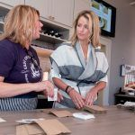 HELPING HAND: Tammy Delfino, left, server, and Kaitlyn Roberts, owner of Easy Entertaining in Providence, prepare for an event. / PBN FILE PHOTO/MICHAEL SALERNO