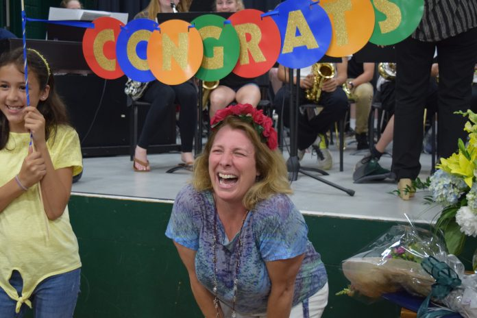 JAMESTOWN SIXTH-GRADE TEACHER Charlene Tuttle celebrates being named the 2019 Rhode Island Teacher of the Year Wednesday at a surprise announement at the Lawn School. / COURTESY R.I. DEPARTMENT OF EDUCATION
