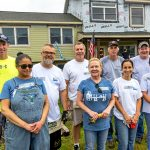 HOUSING HANDS: Town Dock employees volunteer with Habitat for Humanity to renovate a house in the Bradford village of Westerly last August.COURTESY THE TOWN DOCK / COURTESY THE PROVIDENCE MUTUAL FIRE INSURANCE CO.