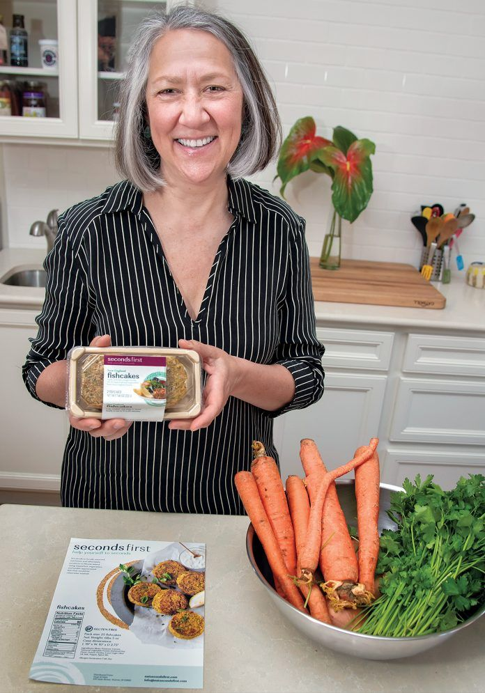 STEADY SELLER: Erika Lamb is the owner and CEO of SecondsFirst, which creates fish cakes for sale to food banks and institutional customers. She sells between 3,000 and 5,000 fish cakes a month. / PBN PHOTO/MICHAEL SALERNO