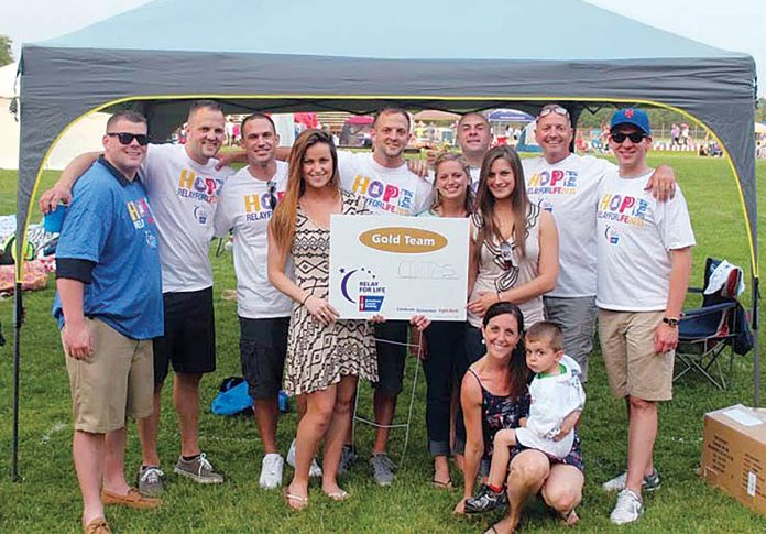 RELAY TEAM: Cintas employees take part in the American Cancer Society's 2015 Hope Relay for Life. The Rhode Island chapter of the American Cancer Society will hold its 10th annual Relay for Life of Greater Westerly June 29-30 at Westerly High School. / COURTESY CINTAS