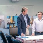 JOB CREATION: Matthew Morrissey, left, vice president of Deepwater Wind, at the energy company's Providence headquarters with John O'Keeffe, manager of operations and marine affairs. Deepwater said 800 temporary construction jobs and 50 permanent maintenance and operations positions will be needed to facilitate the construction of a second Rhode Island-based offshore wind farm. / PBN PHOTO/MICHAEL SALERNO