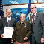NAVAL HONOR: Martha Merriwether, center, Naval Undersea Warfare Center Division Newport's lead for data-program management, was awarded a U.S. Navy Meritorious Civilian Service Award during a ceremony held at NUWC headquarters in Newport June 7. NUWC Newport Technical Director Ron Vien, left, and Don McCormack, executive director, Naval Surface and Undersea Warfare Centers, present the award to Merriwether.  / COURTESY U.S. NAVY