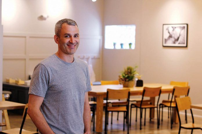 AGGRESSIVE GROWTH: Adam Lastrina, co-owner of Knead Doughnuts, is pictured at the company's newest location at 135 Elmgrove Ave. on the East Side in Providence, which opened in April. The company opened its first location in downtown Providence in December 2016 and hopes to open four locations within five years. / PBN PHOTO/KATE TALERICO
