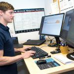THREAT DETECTOR: Michael Carmack, a cybersecurity analyst with Rite-Solutions in Middletown, assesses security threats. / PBN PHOTO/KATE WHITNEY LUCEY