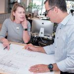 PROPERTY PLANS: Christine M. West, principal at KITE Architects in Providence, looks at some residential plans for a property in Exeter with Albert Garcia, principal. / PBN PHOTO/MICHAEL SALERNO