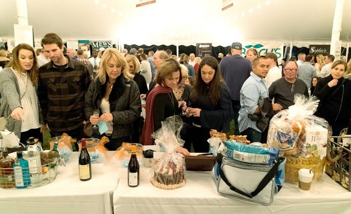 FLAVORFUL SELECTIONS: Attendees observe various food items on display during last year's Taste of Southern Rhode Island event. This year's event, hosted by the Southern Rhode Island Chamber of Commerce, will take place Oct. 18 at Clark Farms in South Kingstown. / COURTESY SOUTHERN RHODE ISLAND CHAMBER OF COMMERCE