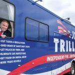 HITTING THE PAVEMENT: Gubernatorial candidate Joseph A. Trillo, a former Republican state representative who has owned several manufacturing and retail businesses in Rhode Island, is running as an independent in the Nov. 6 general election. Trillo uses two buses and a truck to travel around the state and spread his message to voters. / PBN PHOTO/MICHAEL SALERNO