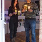 UPCYCLED CANDLES: WICK-ed Candle co-owners Julie Normandin and Jeremy Bliven started the candle-making company, which upcycles glass bottles for use as holders, nearly a year ago. The candles are sold through a retail space at Hope Artiste Village in Pawtucket, as well as a kiosk at Providence Place mall. / PBN PHOTO/RUPERT WHITELEY