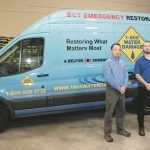 CUSTOMER-FOCUSED: Adam Rizzo, left, franchise owner of 1-800 Water Damage, with Aaron Belanger, restoration tech. Rizzo said the company is customer-service oriented, geared toward meeting customers' expectations.   / PBN PHOTO/Michael Salerno