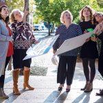 HELPING HANDS: From left, Erin Cox, program officer; Cindy Larson, deputy director; Jeanne Cola, executive director; Megan Ressler, program assistant; and Deanna Bruno, program assistant, at LISC's Providence office. / PBN PHOTO/RUPERT WHITELEY
