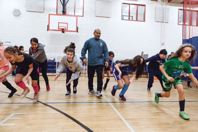 ACTIVE LEARNING: From left, Sherry Lee L., fourth-grader at Veterans Elementary School; Mabel G., sixth-grader at Calcutt Middle School; Isabella R., seventh-grader at The Learning Community; Javier Centeno, co-founder, coach and director of soccer for Project GOAL; Carolina S., fifth-grader at The International Charter School; Gabriela N., fifth-grader at ICS; Christopher G., fifth-grader at ICS; and Julia M., fourth-grader at ICS.  / PBN PHOTO/RUPERT WHITELEY