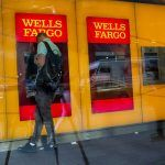 WELLS FARGO WILL pay Rhode Island $1.2 million as part of a $575 million, 50-state settlement over claims that the bank violated consumer protection laws in several capacities. / BLOOMBERG NEWS FILE PHOTO/ERIC THAYER