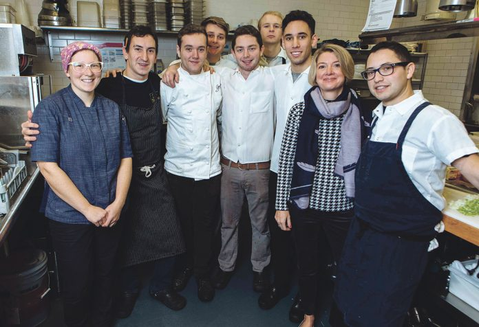 GRACIE'S TEAM: Gracie's Ventures owner Ellen Slattery, second from right, with, from left, Melissa Denmark, executive pastry chef; Matt Varga, executive chef; Brian O'Connell; Griffin Vosbeck; Jordan Fleischer; Johnathan Maccini; Andres Rodriguez; and Josh Berman. Slattery said the biggest challenge has been hiring but the restaurant has had the same team for a year. / PBN PHOTO/RUPERT WHITELEY