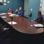FUTURE OUTLOOK: Business and nonprofit leaders in Rhode Island meet with Providence Business News Editor Mark S. Murphy to discuss 2018 and where the state is headed. Starting at the head of the table, background, from left, clockwise: Murphy; Providence College Dean of the School of Business Sylvia Maxfield; VIBCO President Karl Wadensten; Washington Trust Bancorp President and Chief Operating Officer Mark K. W. Gim; Crossroads Rhode Island President and CEO Karen A. Santilli; Blue Cross & Blue Shield of Rhode Island Executive Vice President, General Counsel and Chief Administrative Officer Michele B. Lederberg; and Gilbane Building Co. President and CEO Michael E. McKelvy. / PBN PHOTO/RUPERT WHITELEY