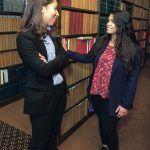 JUDICIOUS EXPERIENCE: Dorca M. Paulino, left, diversity director at the R.I. judiciary, talks with her recent recruit, University of Rhode Island graduate Sharon Santiago. / PBN PHOTO/MICHAEL SALERNO