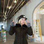 TECH INCUBATOR: Innovate Newport Director of Entrepreneurship and Innovation Tuni Schartner gives a tour of the former Sheffield School on Broadway in Newport, which will serve as the location of Innovate Newport. The business incubator will house small companies, startups and entrepreneurs in the fields of marine and environmental technology, cybersecurity and renewable energy. / PBN PHOTO/KATE WHITNEY LUCEY
