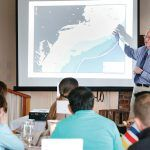 SEAFOOD DISCUSSION: Kevin D.E. Stokesbury, professor at the University of Massachusetts Dartmouth School for Marine Science & Technology, shares a presentation during last year's International Seafood Buyers Luncheon.  / COURTESY SOUTHCOAST CHAMBER OF COMMERCE