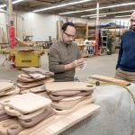FILLING A NEED: Joshua Ellison, right, founder of Edge and End, with employee Jason Harritos, oversees an enterprise that helps people with developmental disabilities to have work experiences and hopefully employment through woodworking. / PBN PHOTO/MICHAEL SALERNO