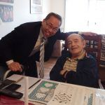 CRANSTON MAYOR Allan W. Fung, left, meets with Vincent DiPippo of Cranston after delivering food as part of Meals on Wheels of Rhode Island's March for Meals initiative. / COURTESY MEALS ON WHEELS OF RHODE ISLAND