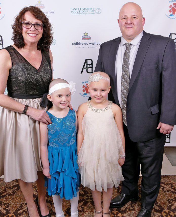 WISH GALA: Emma Zielinski, second from left, and Wish Kid Ella Watters, third from left, pose for a photo with Ella's father, Michael Watters, right, and Ella's mother, Tracy Watters, left, at last year's Children's Wishes Passport Gala. This year's gala, where Emma Zielinski will receive the 2019 Journey Award, will be held on May 10 at Twin River Casino Hotel in Lincoln. / COURTESY DENNIS FORD