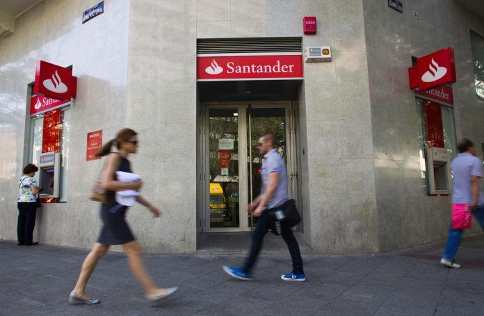 SANTANDER BANK awarded 12 grants for local nonprofit efforts to aid low- to moderate-income communities in the fields of affordable housing, community services, economic and small business development, financial education development, neighborhood revitalization and workforce development. / BLOOMBERG NEWS FILE PHOTO/ANGEL NAVARRETE