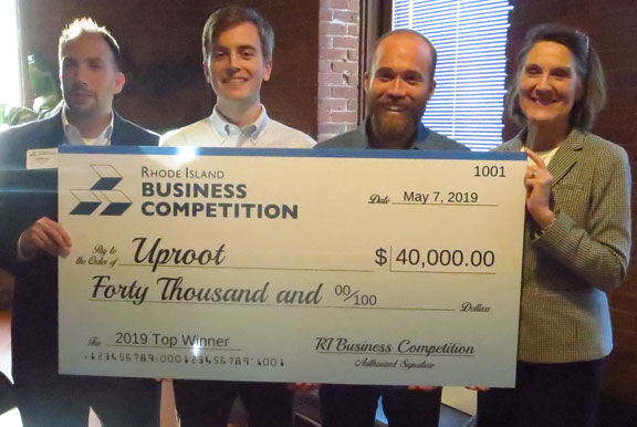 """UPROOT was named the overall winner of the 2019 Rhode Island Business Competition. Above, from left to right:, Anthony Mangiarelli, competition co-chair; Kevin Eve and Jacob Conway, both of Uproot, and Margaret """"Peggy"""" Farrell, competition co-chair. / COURTESY RHODE ISLAND BUSINESS COMPETITION"""